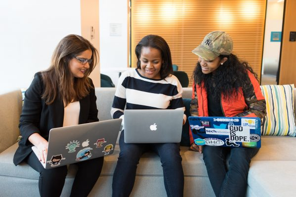 Three women exchanging tips on how to find jobs in post-COVID world