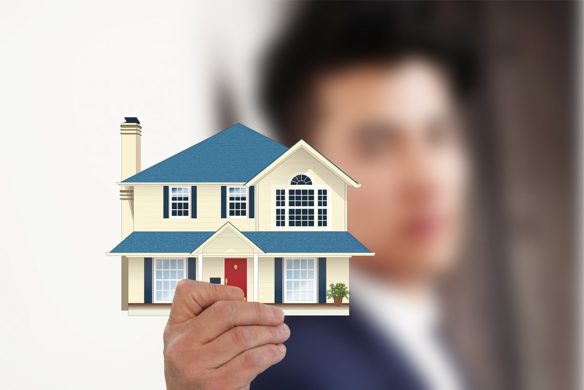 A property manager holding a house